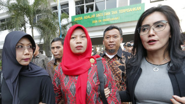 Baiq Nuril Maknun, centre, arrives at the Attorney-General's office in Jakarta, Indonesia, earlier this month.