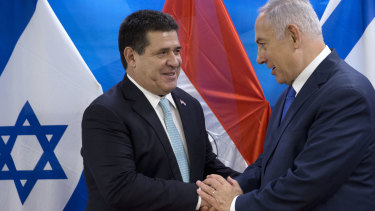 Israeli Prime Minister Benjamin Netanyahu, right, shakes hands with then Paraguayan president Horacio Cartes in Jerusalem in May.