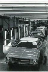 Inspectors check Holdens coming off the assembly line at the GMH Dandenong plant, 1974.