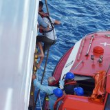 Three men were rescued off New Caledonia by a P&O cruise ship.