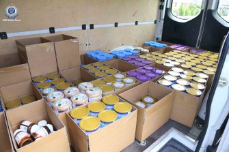 More than 1350 tins of allegedly stolen baby formula were found across two locations in western Sydney.