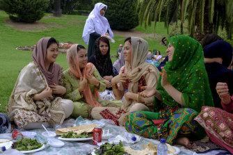 Lunch of many colours: Hazara women on Australia Day at Footscray Park.