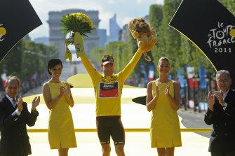 Cadel Evans celebrates his triumph at the Tour de France in 2011.