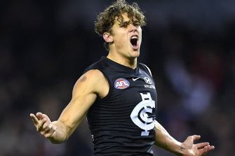 Charlie Curnow celebrates a goal in June 2019, against the Western Bulldogs, just before he was injured.