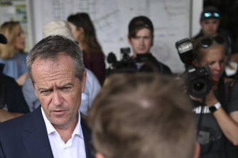 Then-Labor leader Bill Shorten chats with a worker in the Queensland town of Gladstone ahead of the May federal election.