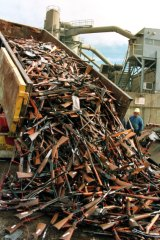 A truck unloads prohibited firearms at a scrapmetal yard in 1997 after the Port Arthur massacre a year earlier.