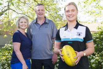 Canberra-based AFLW draft prospect Maggie Gorham, with her parents Brett Gorham and Donna Gorham at their Canberra home.
