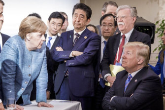 Condemnation: World leaders gather at the second day of the G7 meeting in Canada last year.