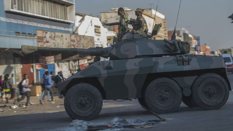 An army tank patrols on a street in Harare during protests by opposition party supporters on Wednesday.