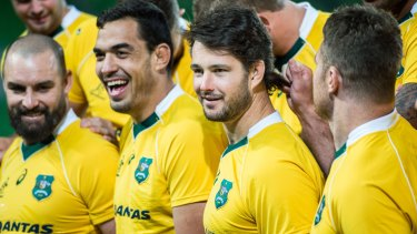Sam Carter in Wallaby gold alongside Rory Arnold and Scott Fardy.