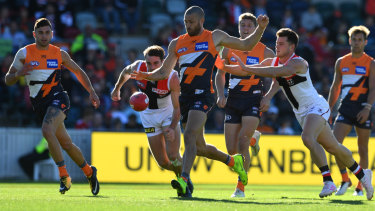 Sam Reid  clears the ball for the Giants in Canberra.