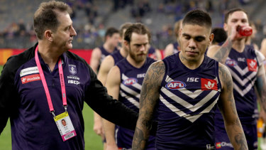 Digging in: Fremantle coach Ross Lyon with Dockers star Michael Walter.