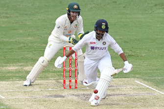 Australian captain and wicketkeeper Tim Paine watches on as Indian surprise packet Shardul Thakur bats at the Gabba on Sunday.