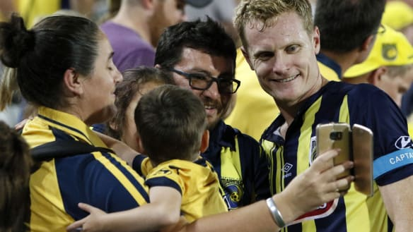 Wizard of Woy Woy: Matt Simon poses with fans after the win.