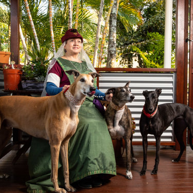 Susan Cooper – in her noblewoman outfit – at her Gold Coast home with her three greyhounds (from left) Rory, Lucy-lou and Marley.