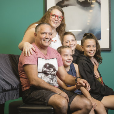 James and Fiona with three of their nine kids - Matilda, Eddie and Olivia.