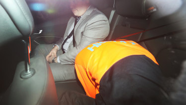Jacob Elliott, 18, being driven by police into Melbourne Magistrates Court.