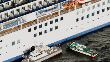 Passengers who tested positive for coronavirus were taken from the Diamond Princess to hospital on February 5.