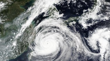 A satellite image released by NASA shows typhoon Maysak over Japan's southernmost islands on Tuesday.