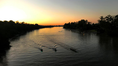 Rowers train on the Brisbane River on a cold winter morning.