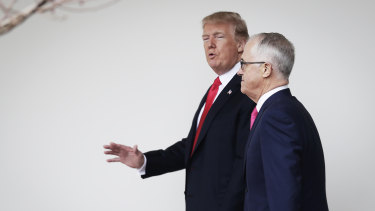US President Donald Trump walks with former prime minister Malcolm Turnbull.