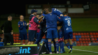 Newcastle Jets players celebrate a recent win over Melbourne City.