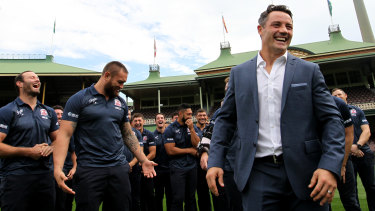 Support players: The entire Roosters squad gathers for Cooper Cronk's retirement announcement on Monday.