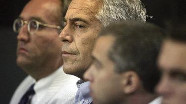 Jeffrey Epstein, centre, in court in 2008.
