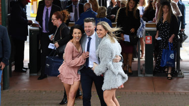 Racegoers arrive at the Caulfield Cup