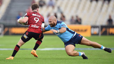 Waratahs hooker Robbie Abel attempts to tackle a Crusaders player.