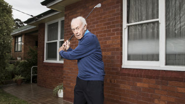 Tom Sample out the front of his Kingsford home. The 97-year-old plays golf twice a week, still does all his own shopping and mows his lawn.