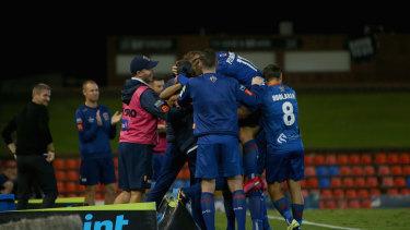 Newcastle Jets celebrate Monday's win over Melbourne City.