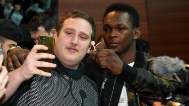 What pressure? Adesanya jokes around with a fan in Melbourne.