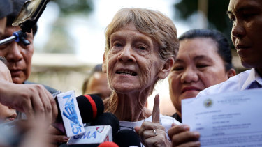 Australian missionary Sister Patricia Fox gestures as she is interviewed by reporters after she was released from custody at the Bureau of Immigration in Manila, Philippines.
