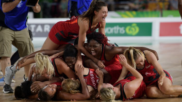 Stacks on: England celebrate their gold medal.