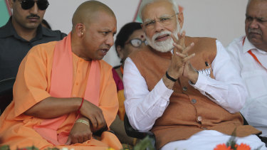 Uttar Pradesh Chief Minister Yogi Adityanath, left, and Indian PM Narendra Modi at an election campaign rally last year.