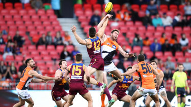 Ruck and ready: Stefan Martin of the Lions contests a bounce against Giant Dawson Simpson.
