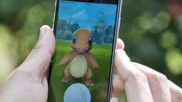 A Pokemon Go player attempts to catch a Charmander character in New Delhi, India.