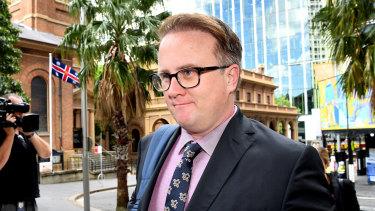 Daily Telegraph journalist Jonathon Moran on his way to court on Monday.