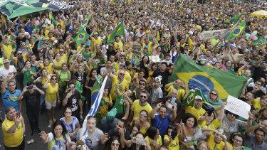 Supporters of Brazilian presidential candidate Jair Bolsonaro, rally along Paulista Avenue in Sao Paulo on Sunday.