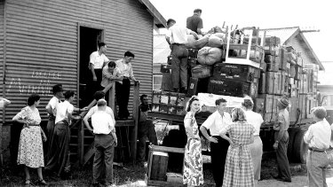 The belongings of reluctant European migrants are loaded onto a truck at Bradfield Park after authorities ordered them to be relocated to other camps to make way for new arrivals from Britain in 1951.