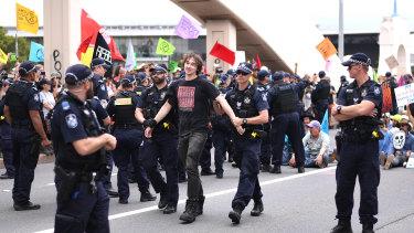 Police arrest Extinction Rebellion activists on the William Jolly Bridge on October 11.