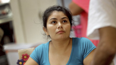 Carla, a migrant mother from El Salvador, talks with other parents at the Annunciation House,, in El Paso, Texas. Thirty-two parents separated from their children are staying at the home as they wait to be reunited with their children.