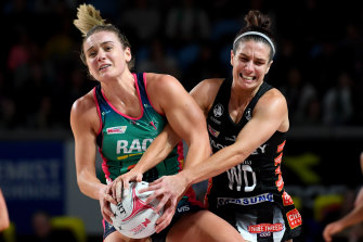 The Magpies' Ashleigh Brazill (right) clashes with the Vixens' Liz Watson.