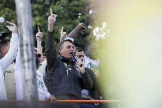 Bolsonaro talks to supporters after the rally.