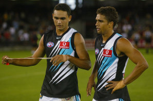 Shaun and Peter Burgoyne after Shaun's AFL debut in 2002.