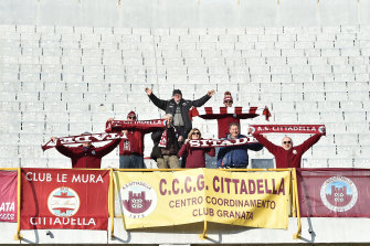 A group of Cittadella fans celebrate an away win over Ascoli in January 2018.