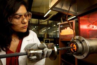 Professor Veena Sahajwalla, at a laboratory furnace at the UNSW SMaRT Centre.