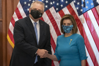 Prime Minister Scott Morrison, left, shakes hands with US House Speaker Nancy Pelosi.