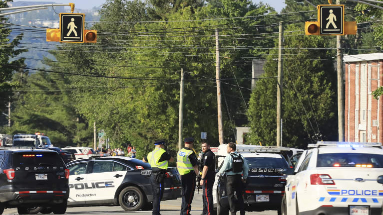 Fredericton police say two officers were among four people who died.